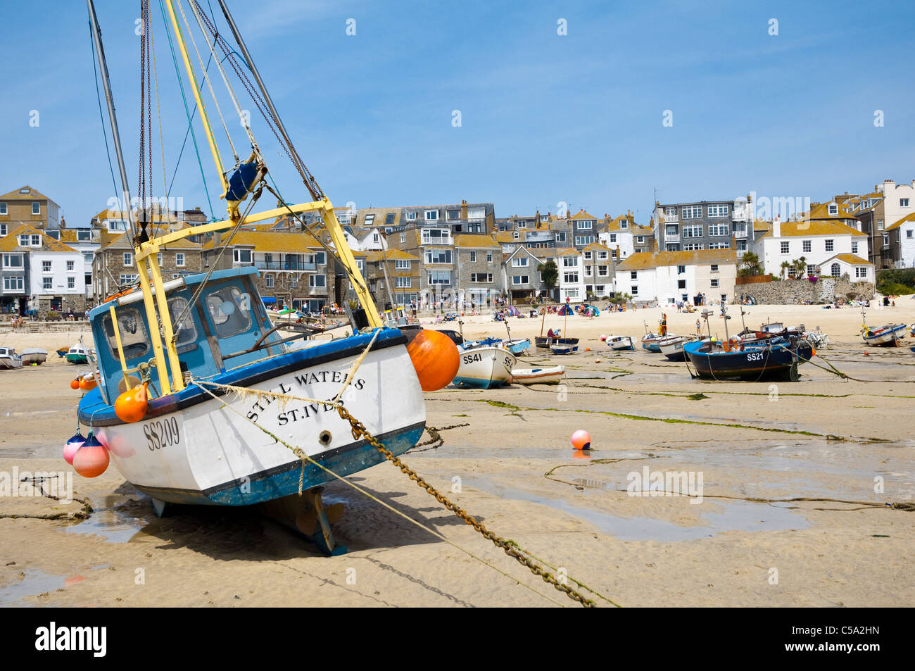 St Ives, Cornwall - the harbour at low tide.  Fishing boat in foreground named 'Still Waters St Ives'. UK Stock Photo