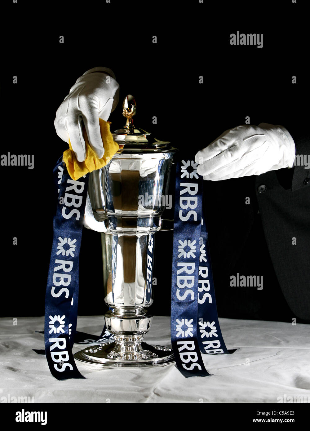The RBS Six Nations Trophy is polished ahead of the Rugby Union competition. - Stock Image