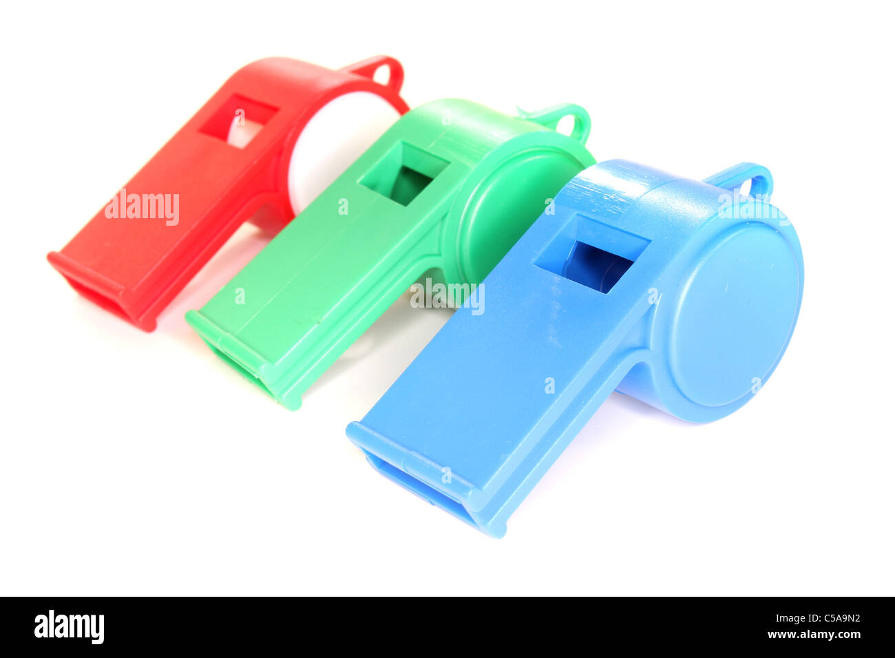 Colorful Trill whistles on a white background - Stock Image