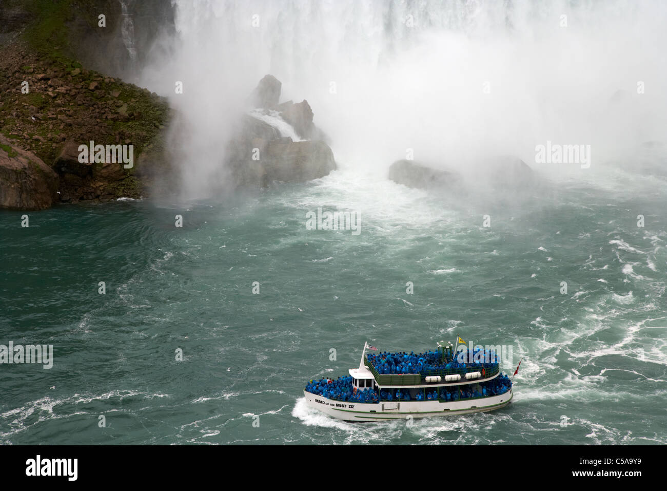 maid of the mist boat ride below niagara falls ontario canada - Stock Image