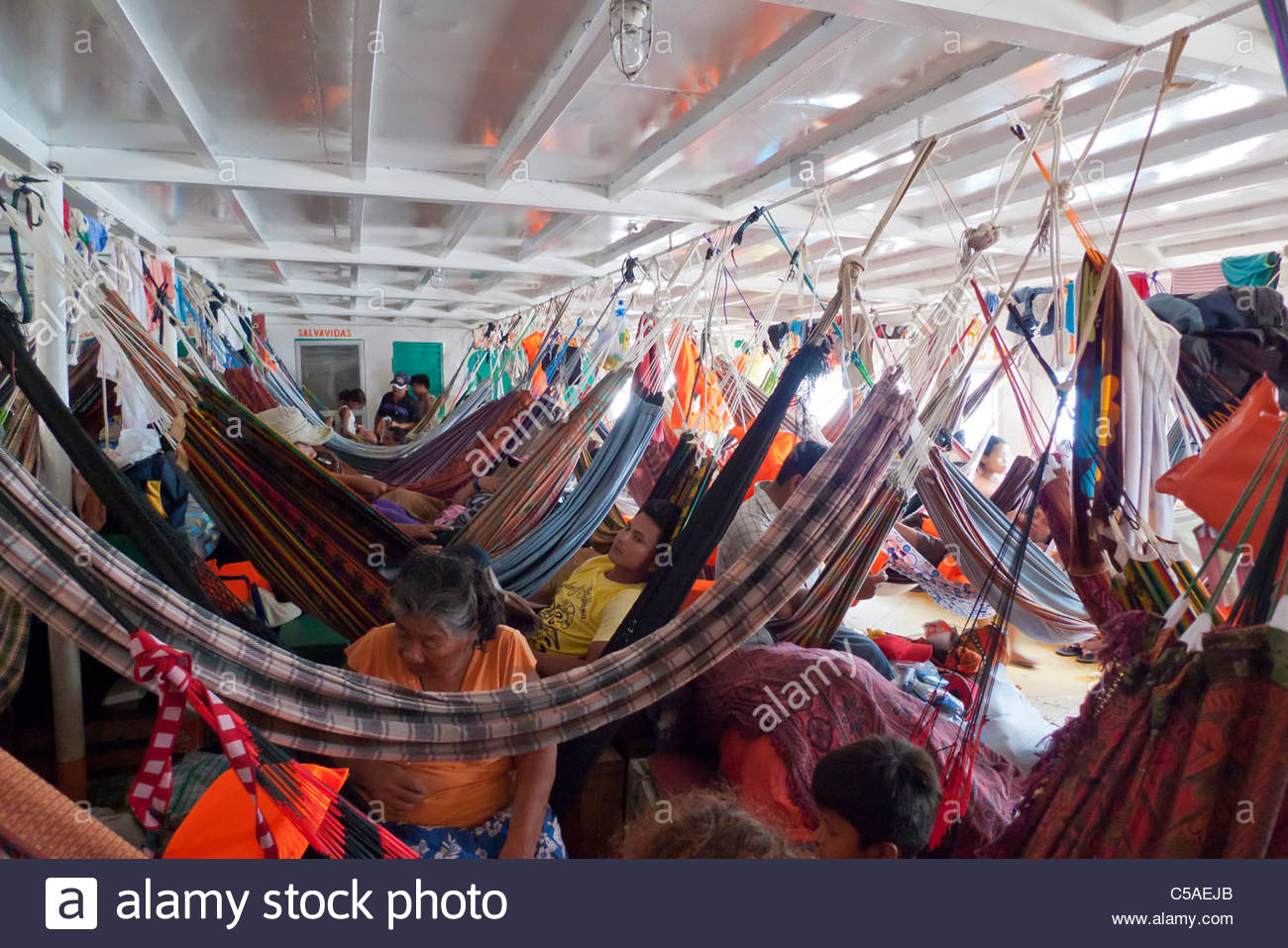 Crowded interior of a river boat on the Ucayali River, Loreto, Peru - Stock Image