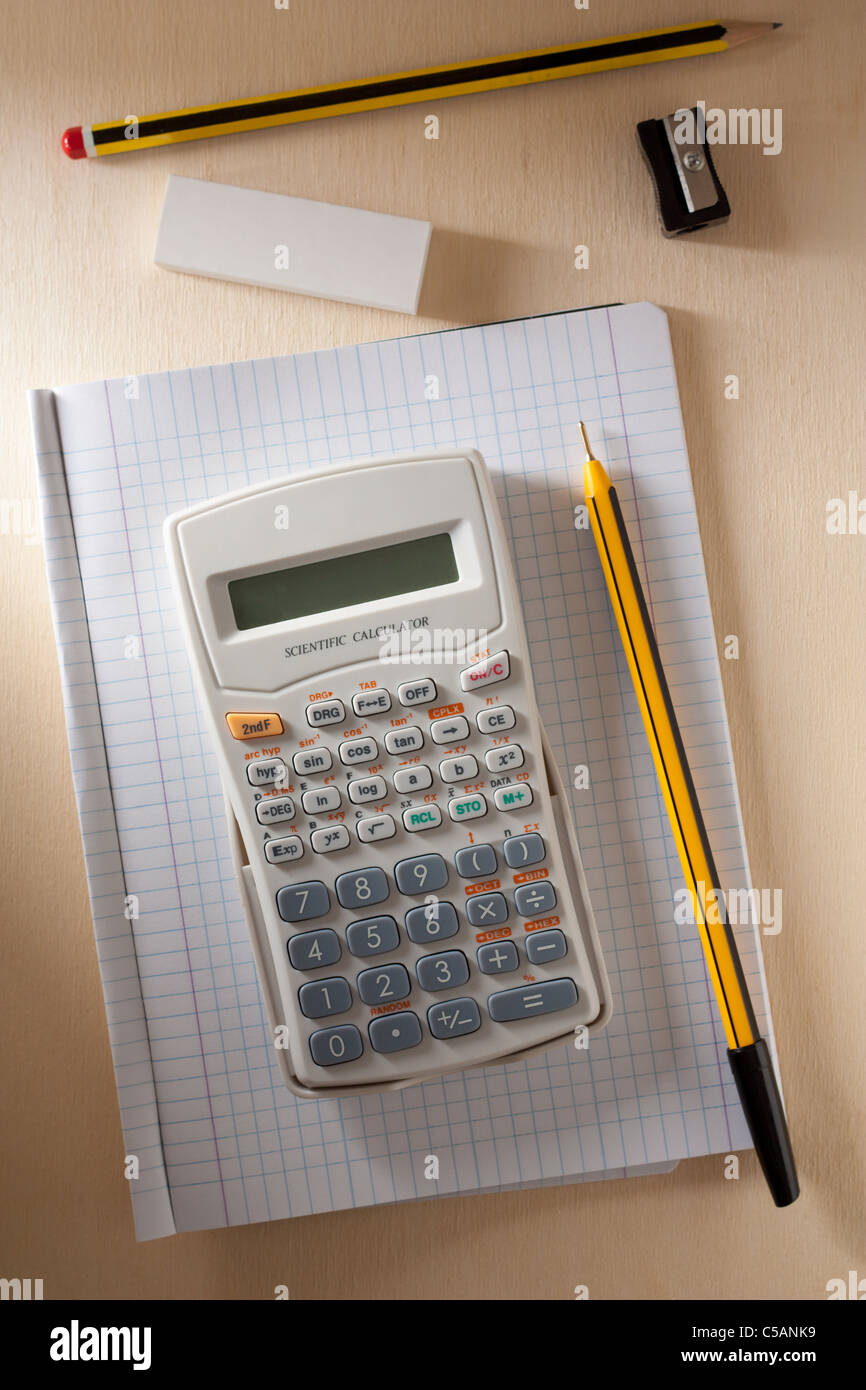 Calculator with Exercise Book, Pen, Pencil, Rubber and Pencil Sharpener - Stock Image