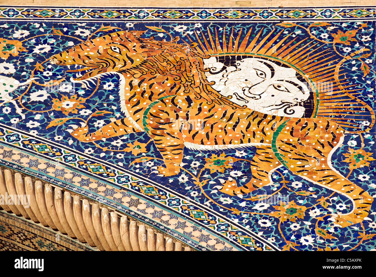 Animal iconography on Sher Dor Madrassah on Registan Square, Samarkand, Uzbekistan - Stock Image