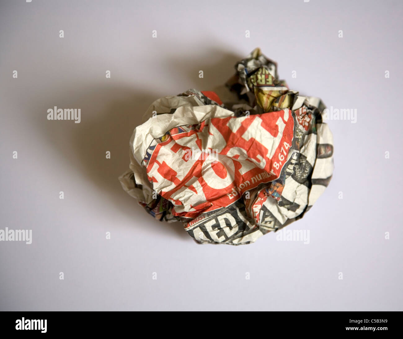News Of World crumpled into a ball - Stock Image