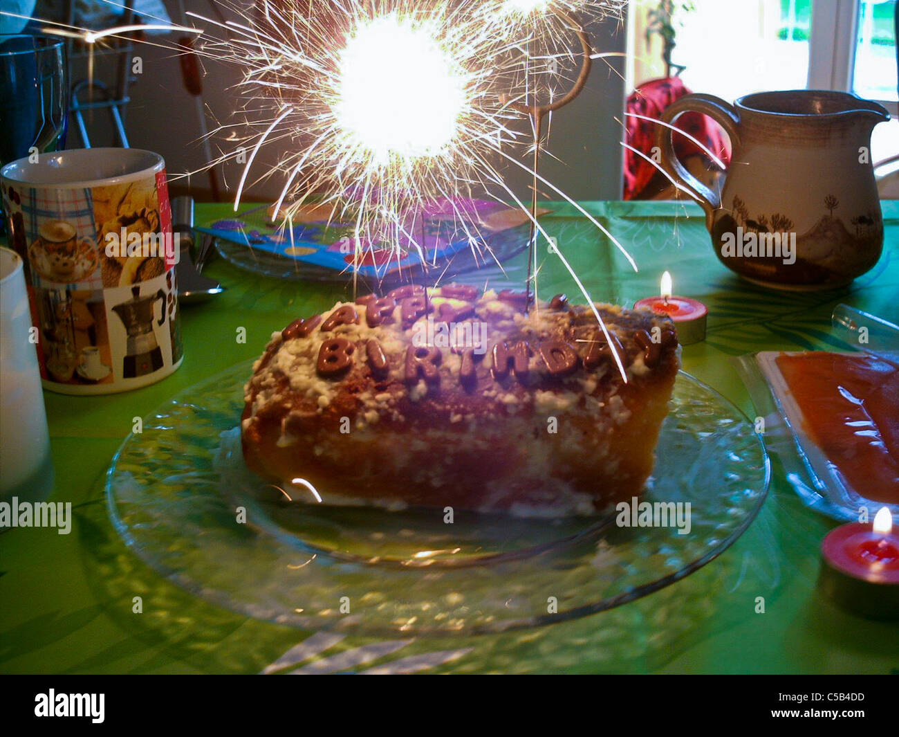 Homemade Birthday Cake With Lit Sparkler On Table