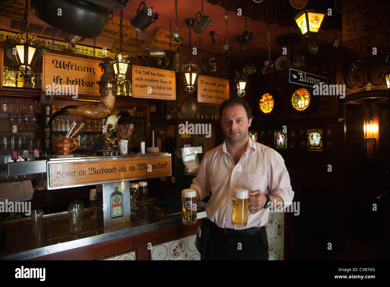 Frankfurt german waiter with two beers at iconic historic beer bar kneipe City Hall Rathausplatz - Stock Image