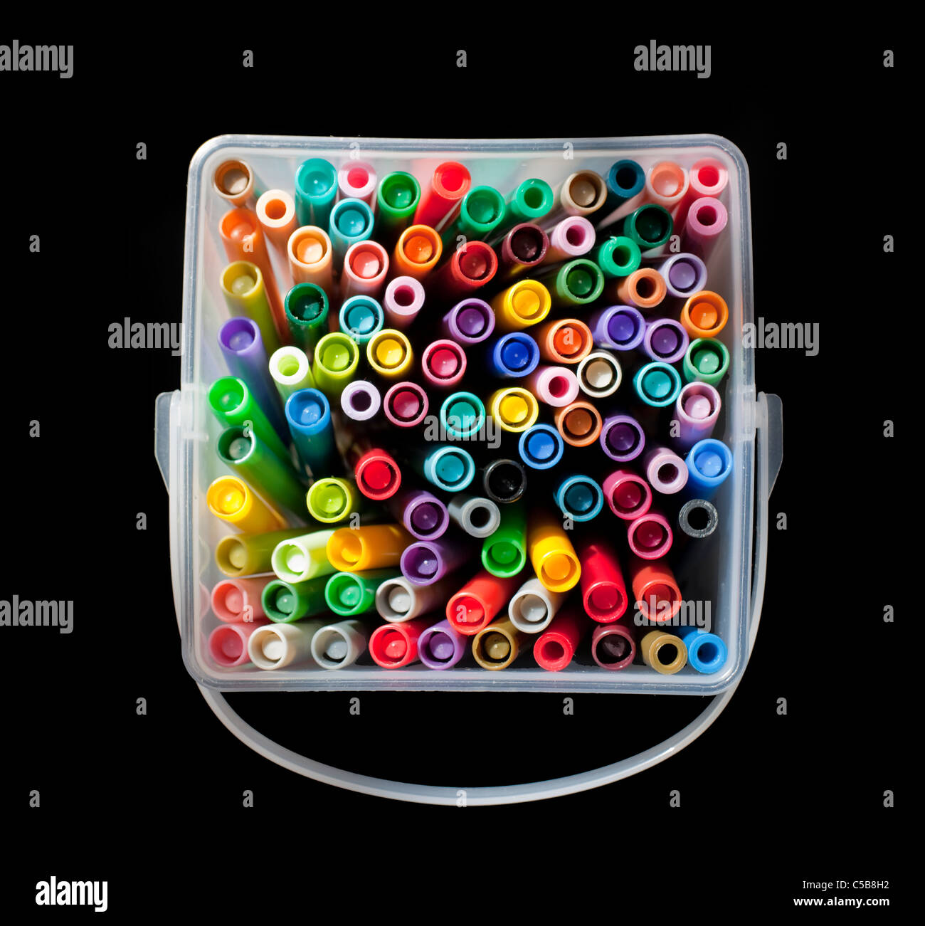 Plastic container full of colourful felt tip pens - Stock Image