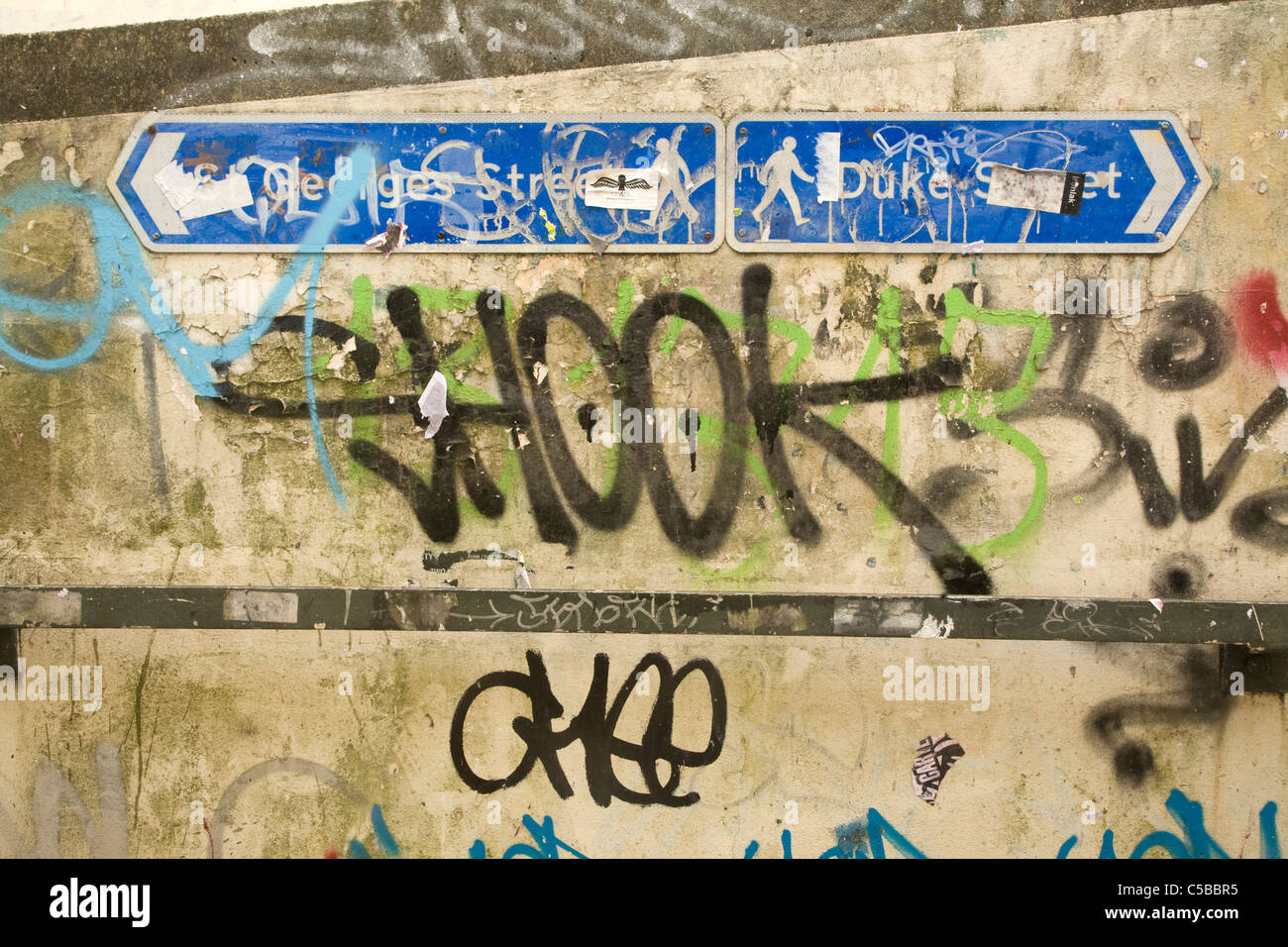 Graffiti on concrete walls and street signs norwich england stock image