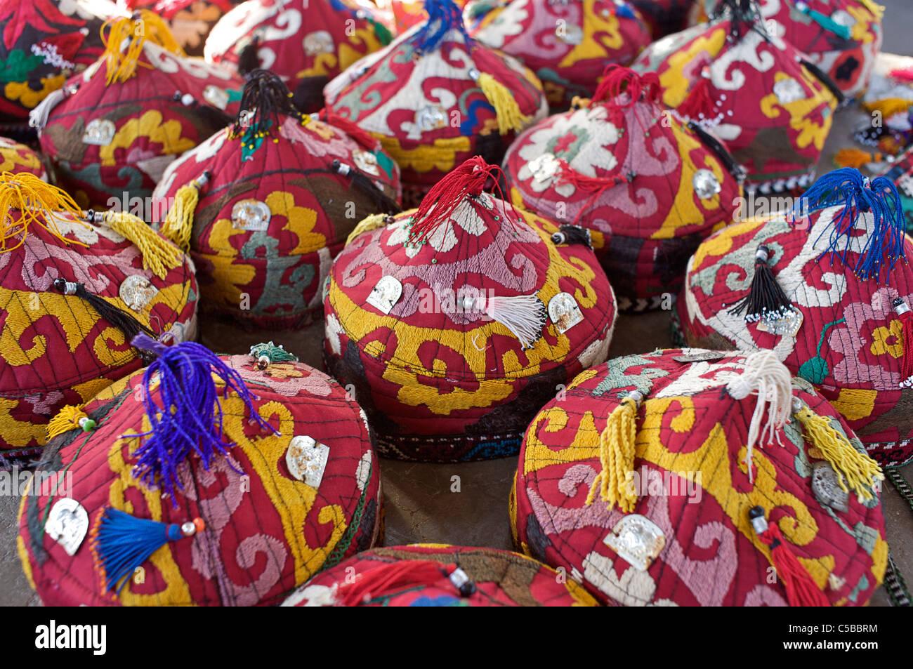 Embroidered caps, Urgut market, Samarkand, Uzbekistan - Stock Image