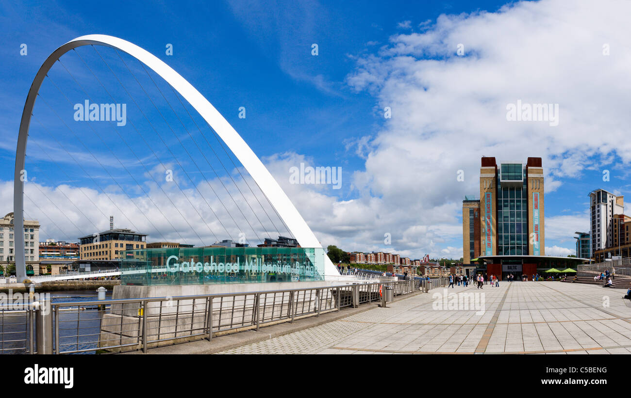 The Millennium Bridge and Baltic Centre for Contemporary Arts, Quayside, Gateshead, Tyne and Wear, UK - Stock Image