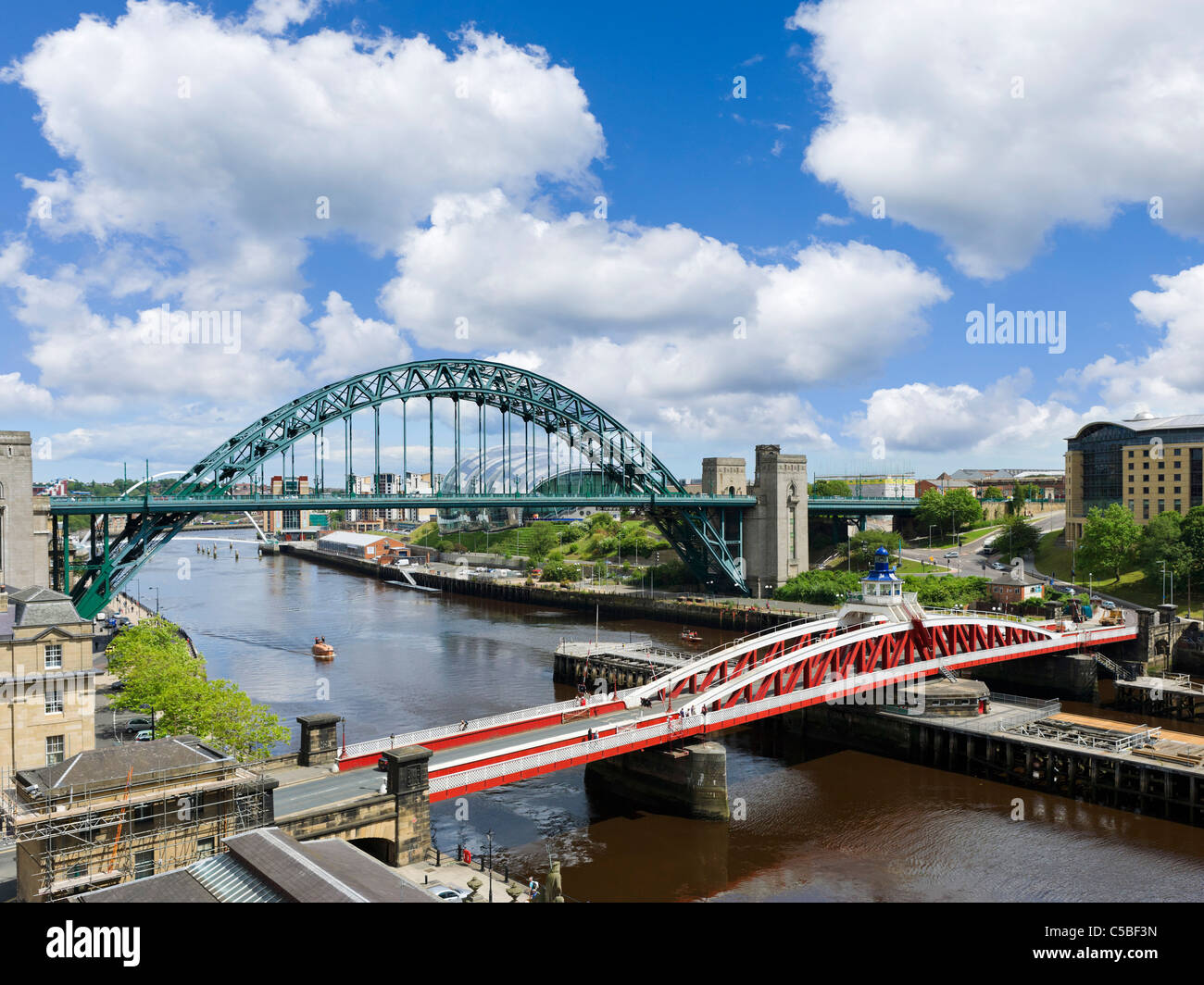 View of the River Tyne showing the Swing Bridge and Tyne Bridge with the Sage Gateshead behind, Newcastle upon Tyne, Stock Photo
