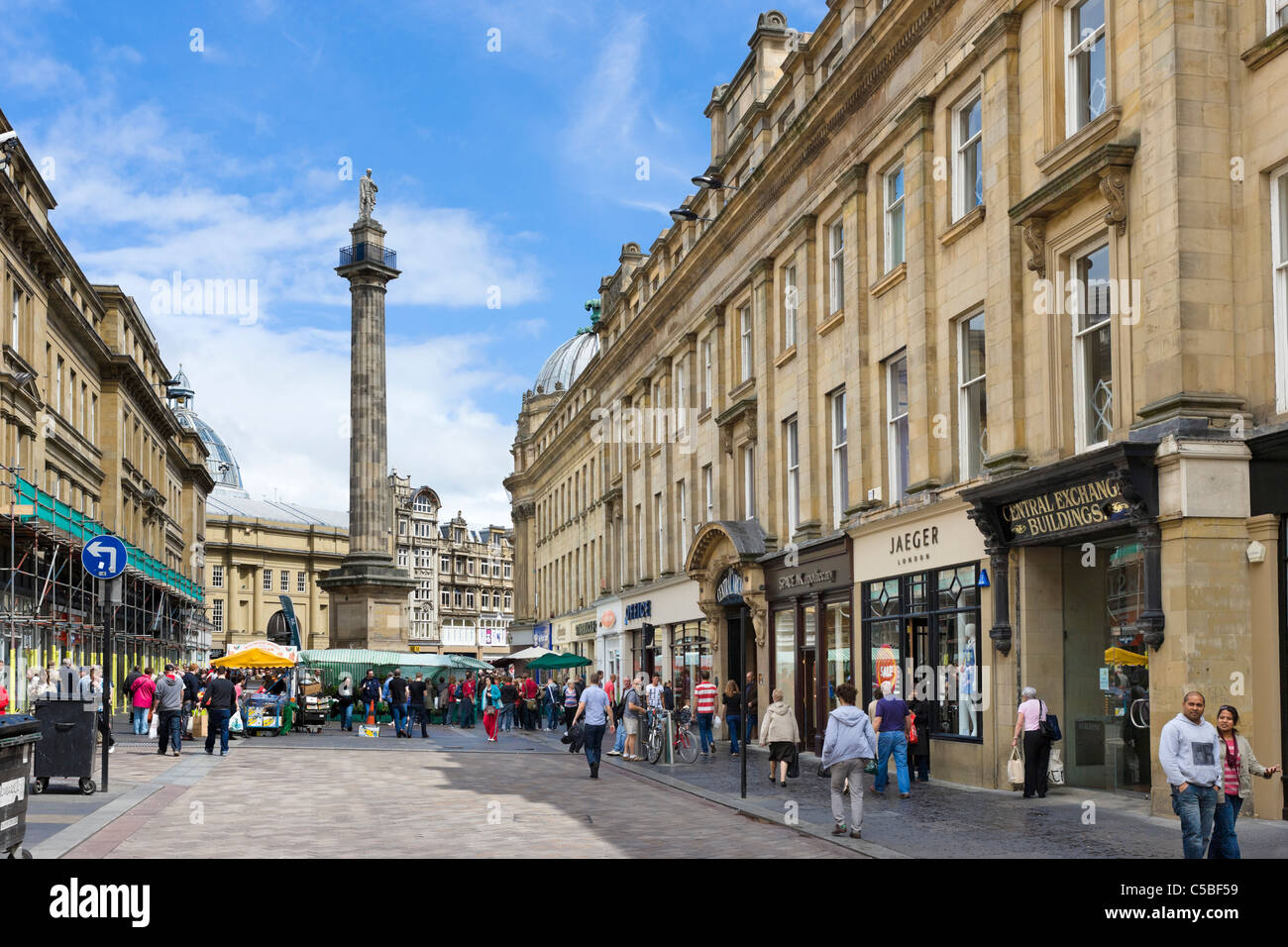 Shops on Grainger Street with Grey's Monument at the far end, Grainger Town, Newcastle upon Tyne, Tyne and Wear, - Stock Image