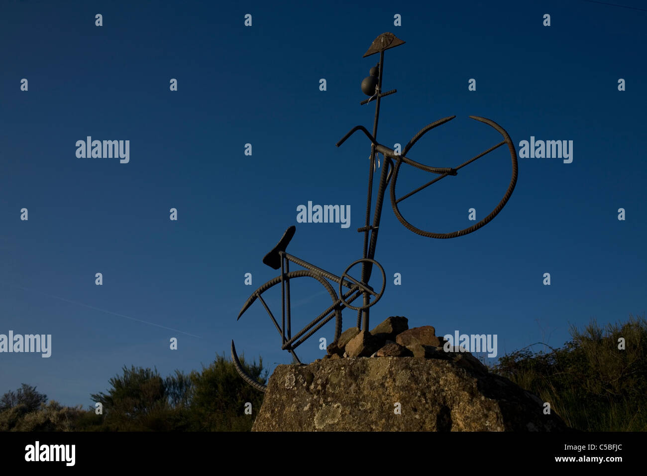 An sculpture of a bicycle is displayed in the French Way of St. James, El Bierzo region, Castilla y Leon, Spain, - Stock Image
