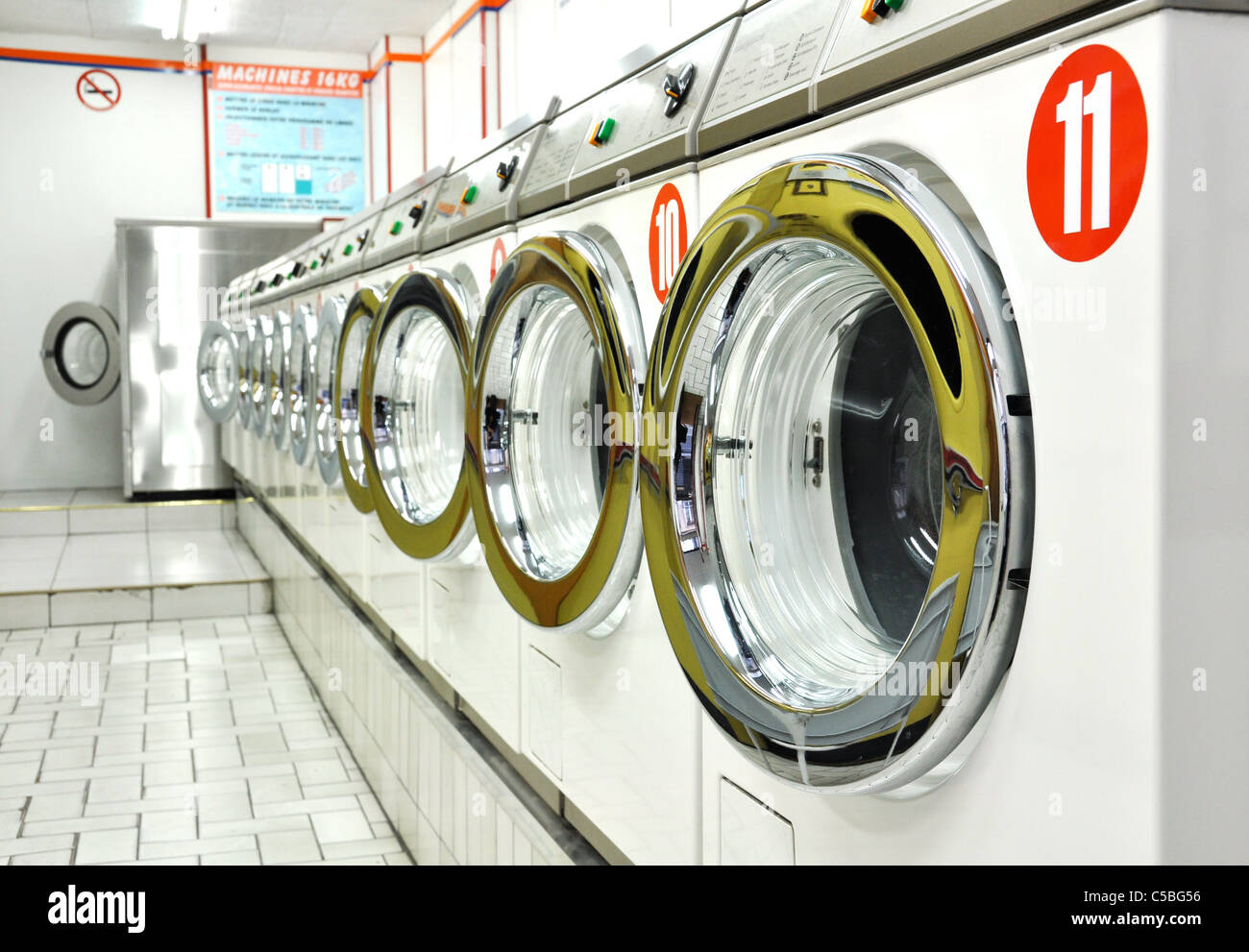 Row of washing machines in a laundrette - Stock Image