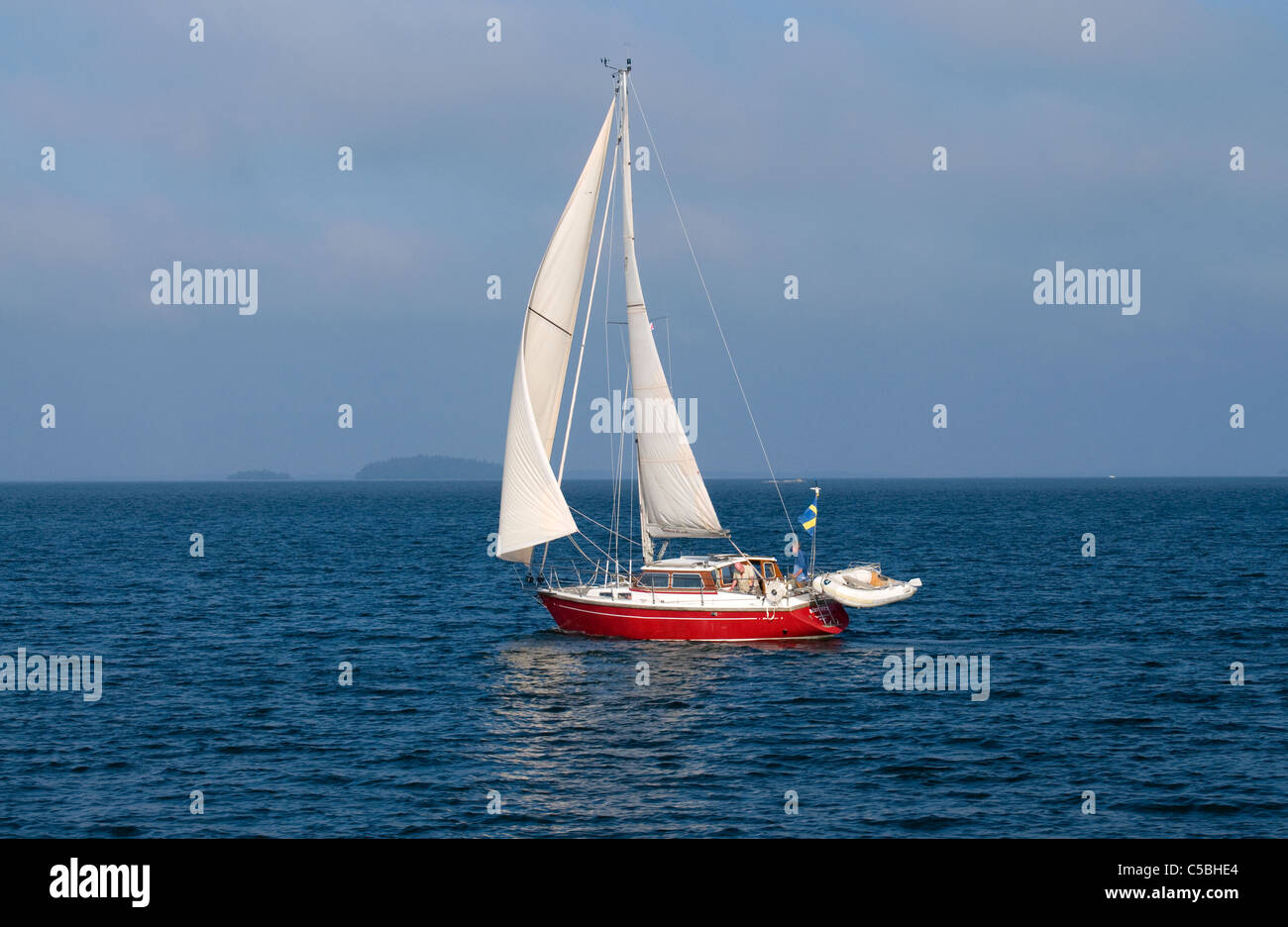 Red Sailing-boat sailing the waters of Stockholm archipelago, Sweden - Stock Image