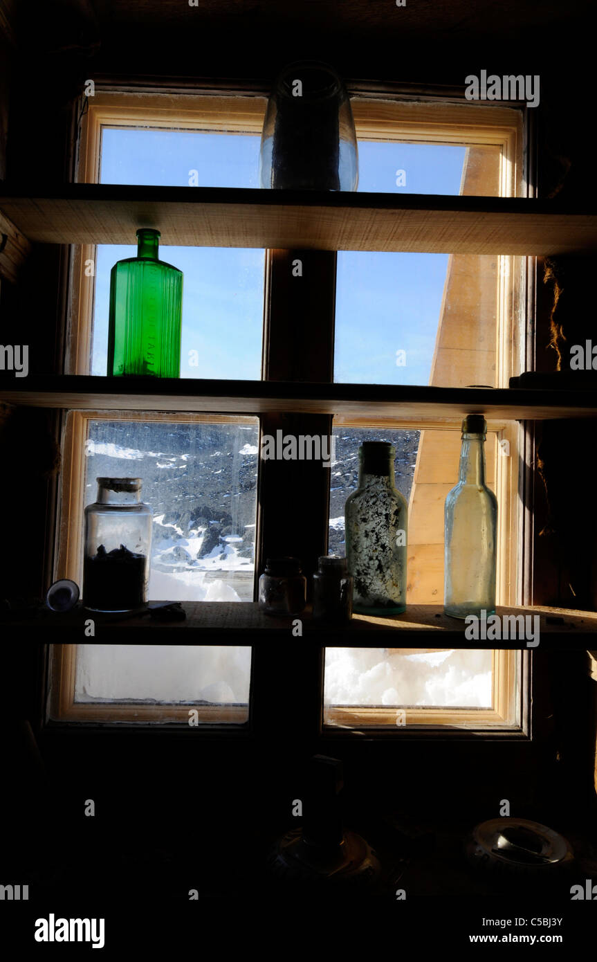 Historic artifact at bottle in window Shackleton's Hut Cape Royds Antarctica - Stock Image