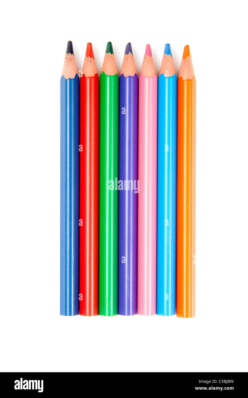A close up to assorted colored pencils lined up vertically on white Stock Photo