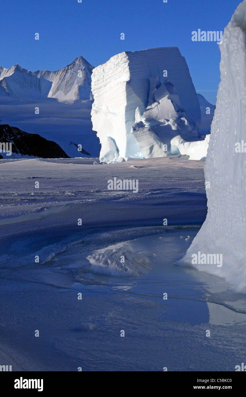 Mount Herschel with large ice berg from Cape Hallett northern Ross Sea Antarctica - Stock Image