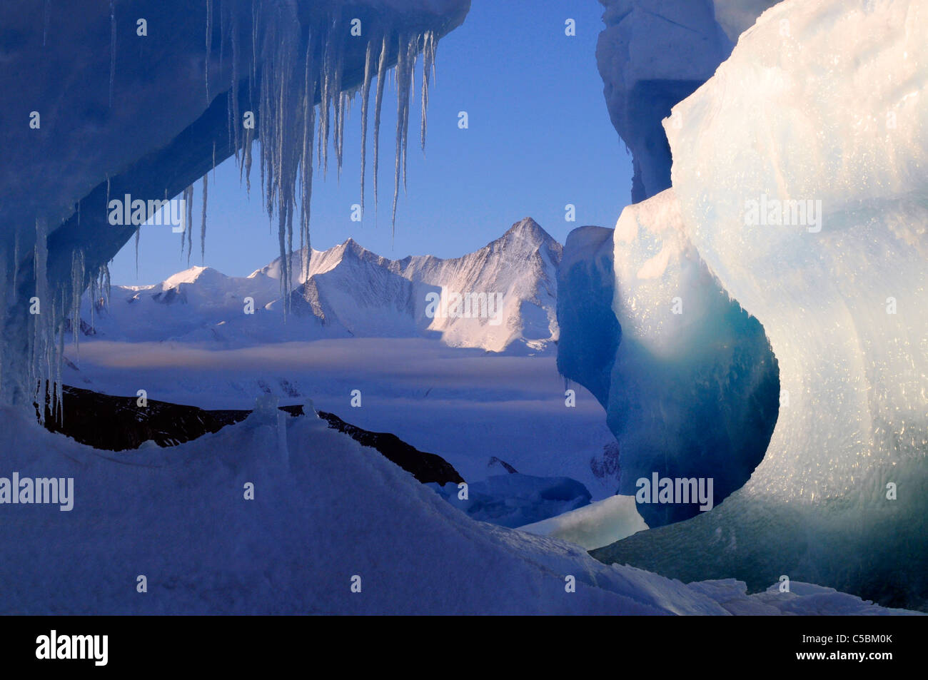 Mount Herschel framed by icicles and ice berg from Cape Hallett northern Ross Sea Antarctica - Stock Image
