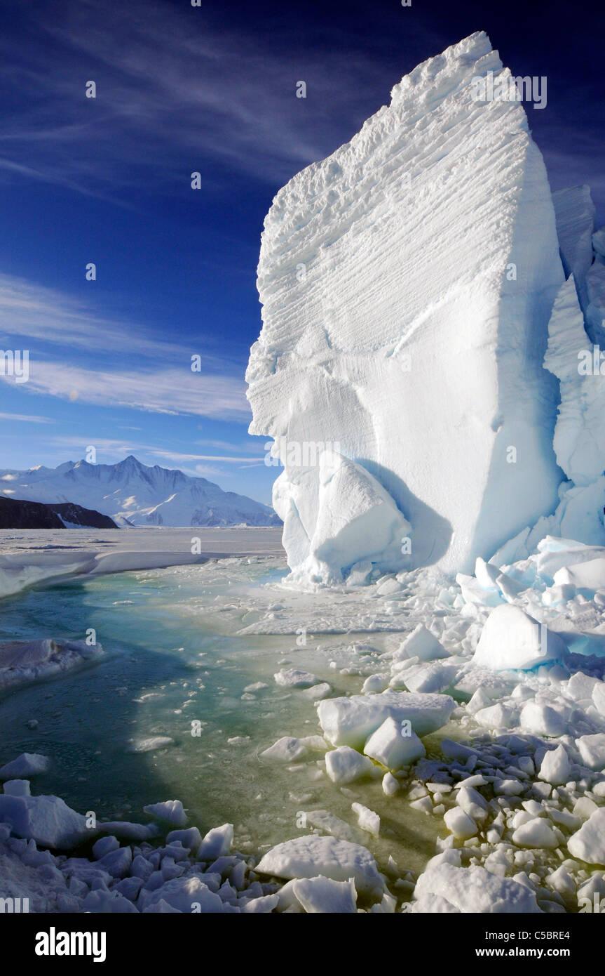 Mount Herschel with large ice berg and marine algae in pool near Cape Hallett northern Ross Sea Antarctica - Stock Image