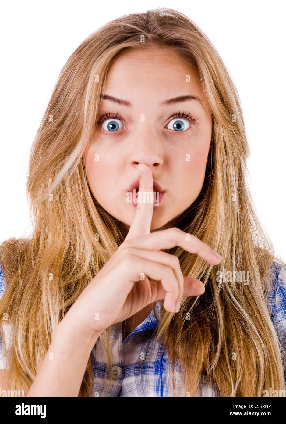 women says ssshhh to maintain silence on a white background stock