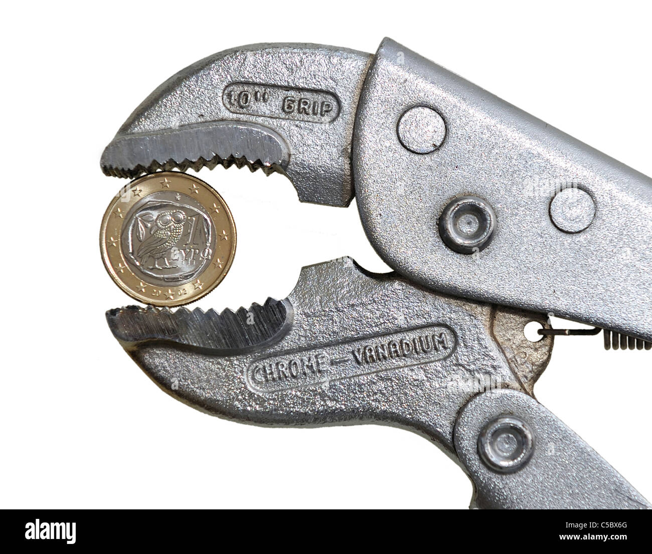 Euro Coin in Pliers - Stock Image