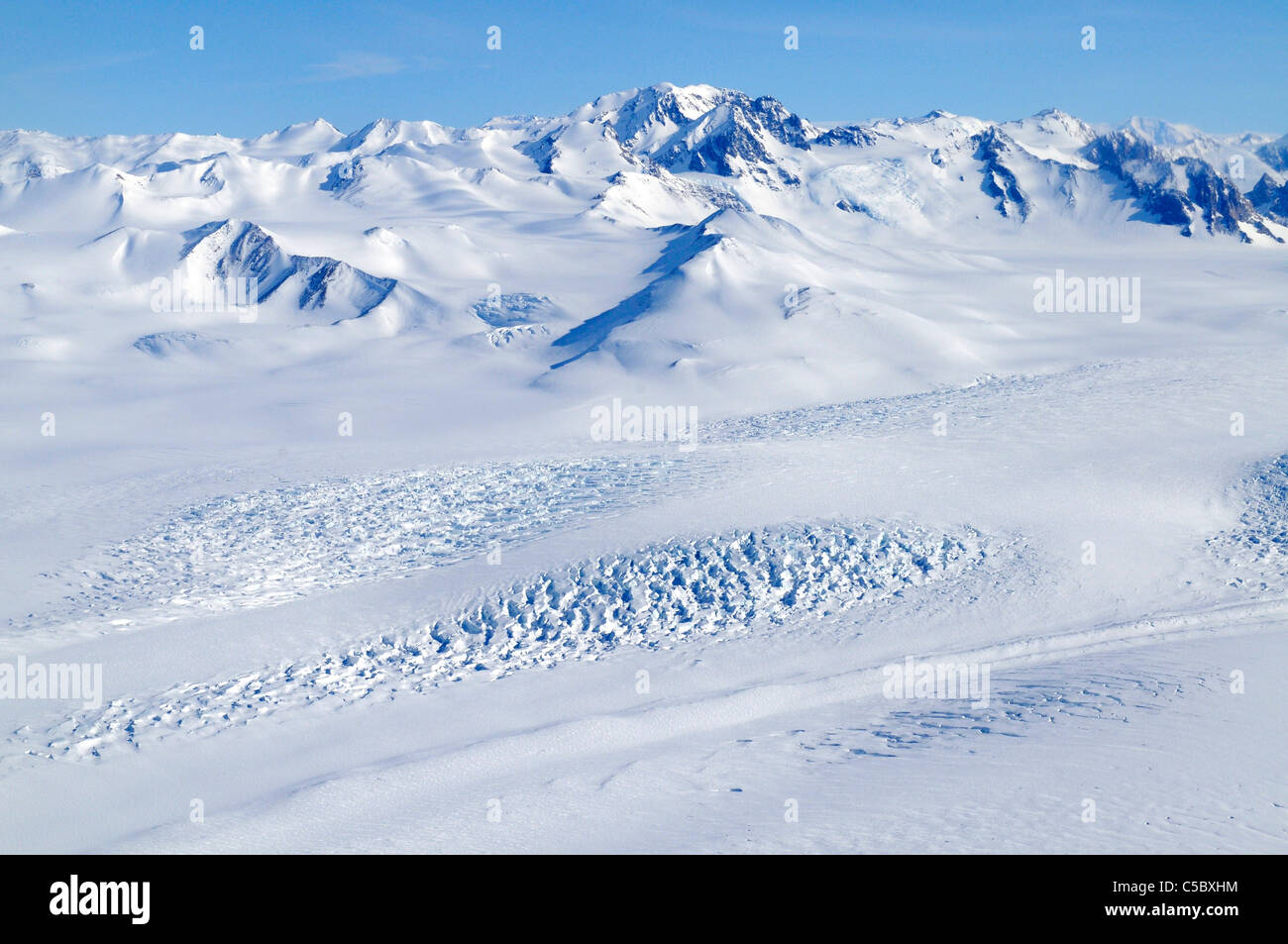 Large glacier flowing from Polar Plateau to Wood Bay Ross Sea Antarctica - Stock Image