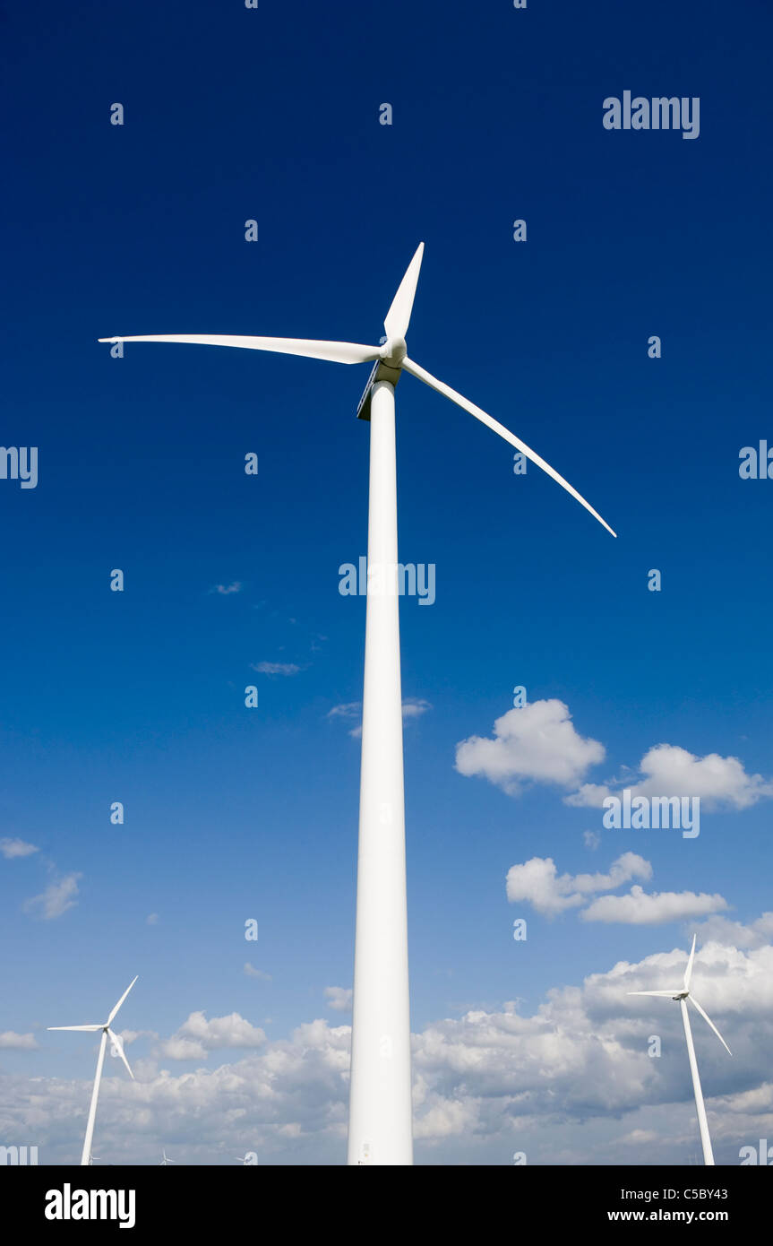 Low angle view of wind turbines against the sky - Stock Image