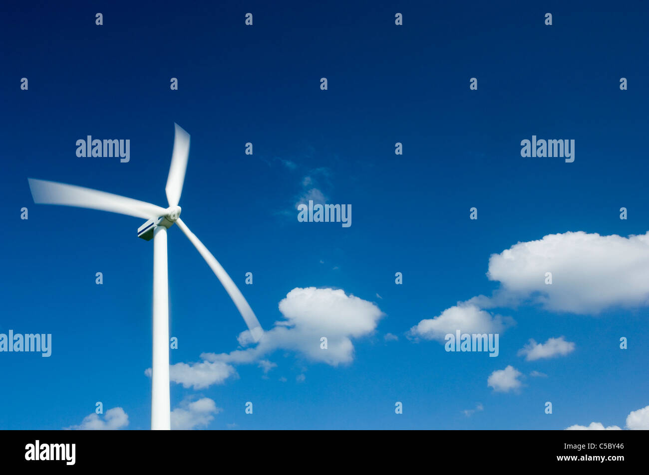 Low angle view of a wind turbine against the sky - Stock Image
