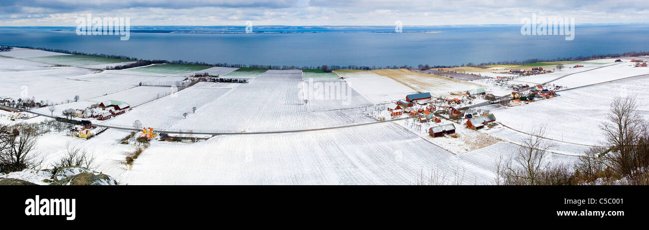 Panoramic shot of wintery landscape with sea in the background - Stock Image