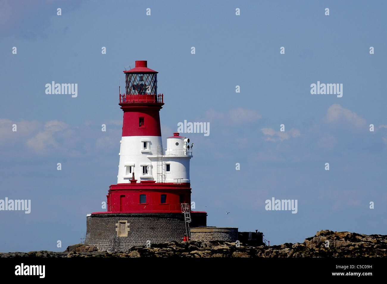 Longstone Lighthouse on Longstone Rock Farne Islands four miles offshore made famous by Grace Darling and her father Stock Photo
