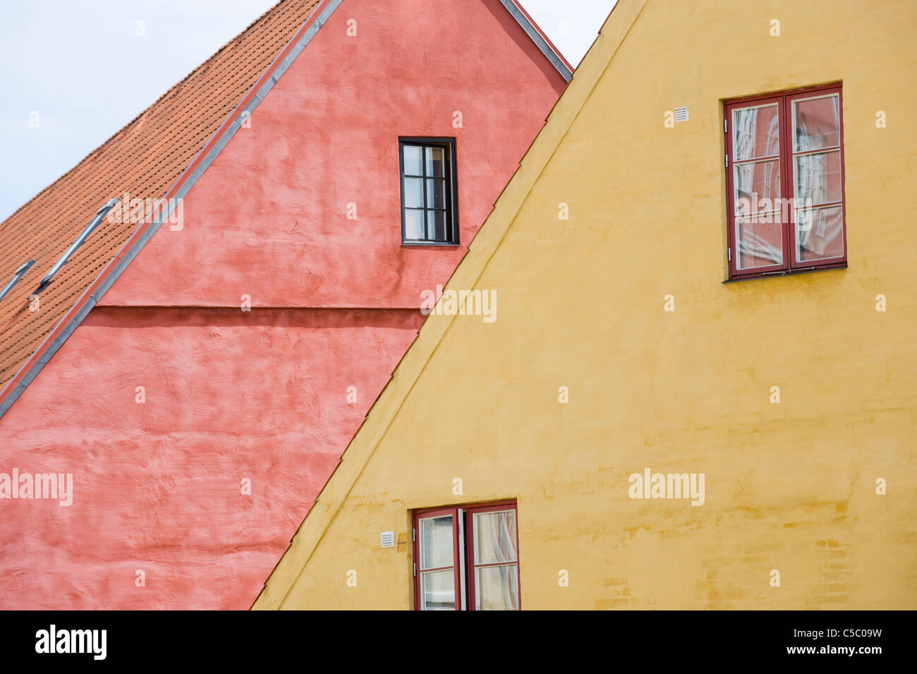 Detail of pink and yellow medieval houses - Stock Image