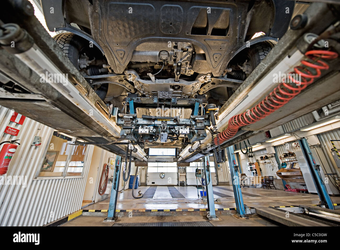 View from below of a vehicle during inspection - Stock Image