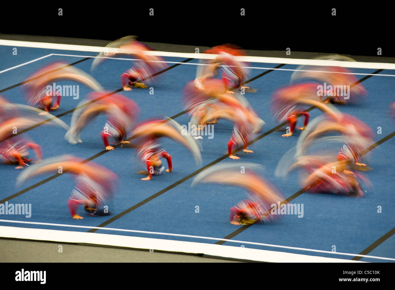 People in blurred motion at the gymnastics squad - Stock Image