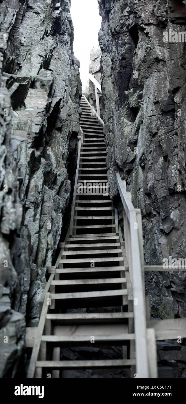 View of narrow stairways amid rocks - Stock Image
