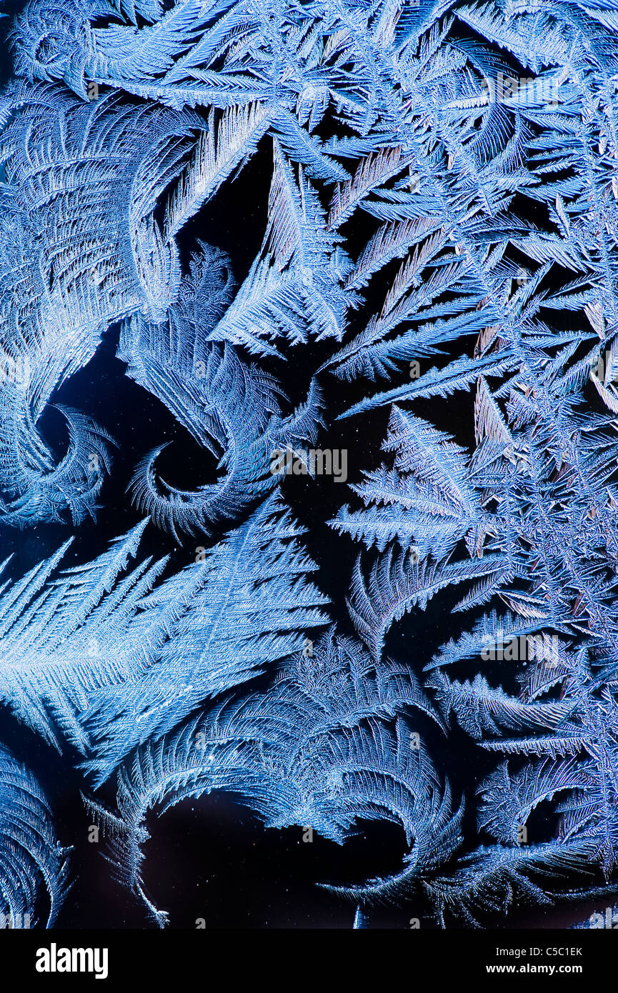 Close-up of ice crystals against black background - Stock Image