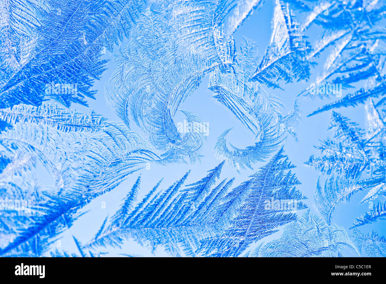 Background of ice crystals against blue background - Stock Image