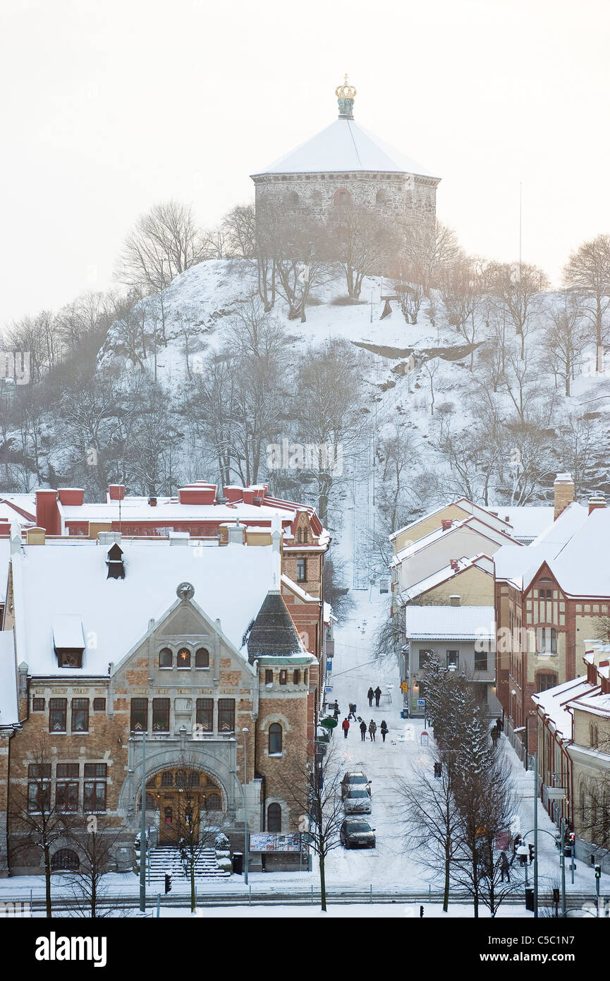 Winter shot of Skansen crown at a distances with houses and street in the foreground at Christmas - Stock Image