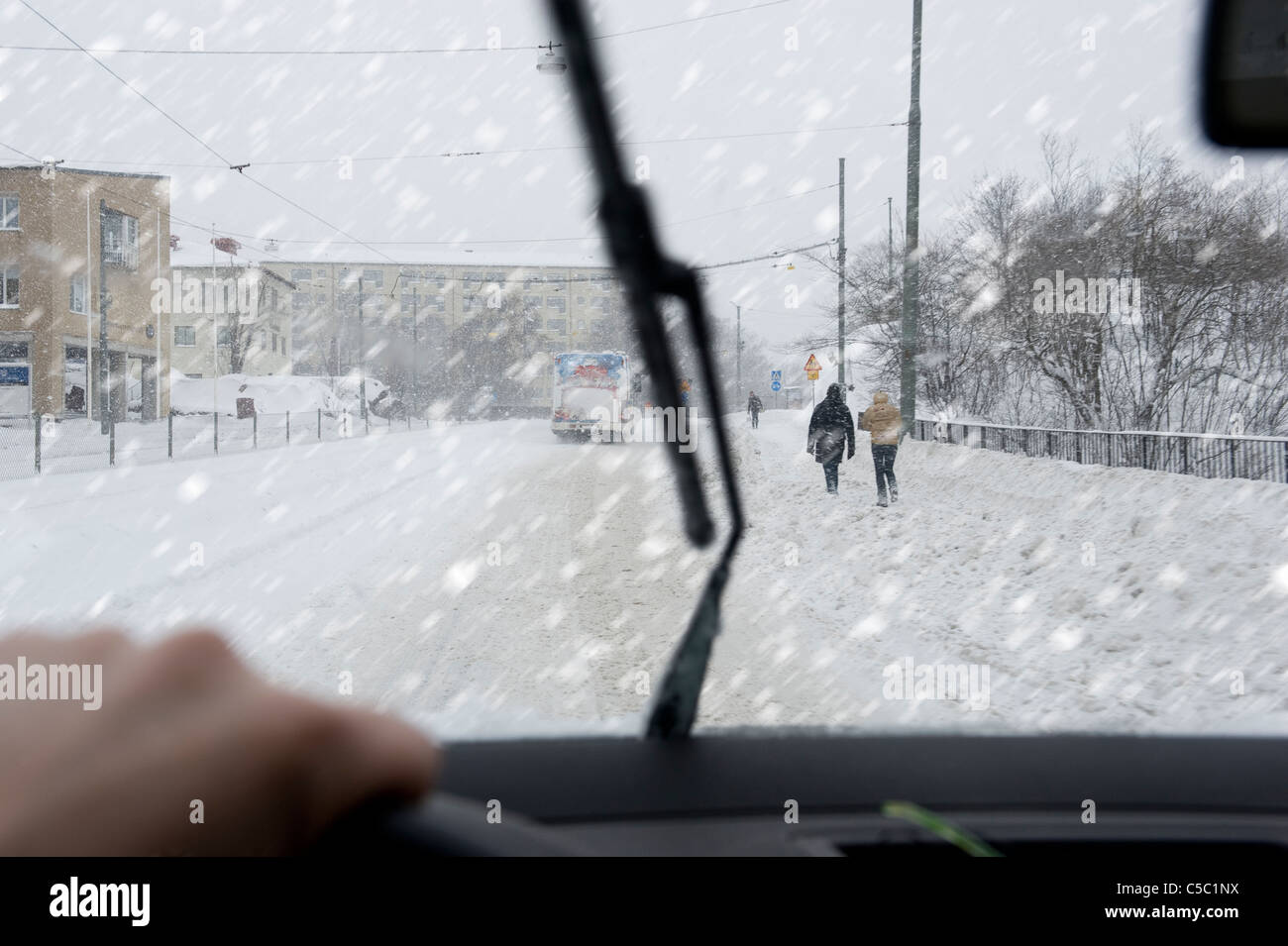 View of street snowfall from the car's windshield - Stock Image