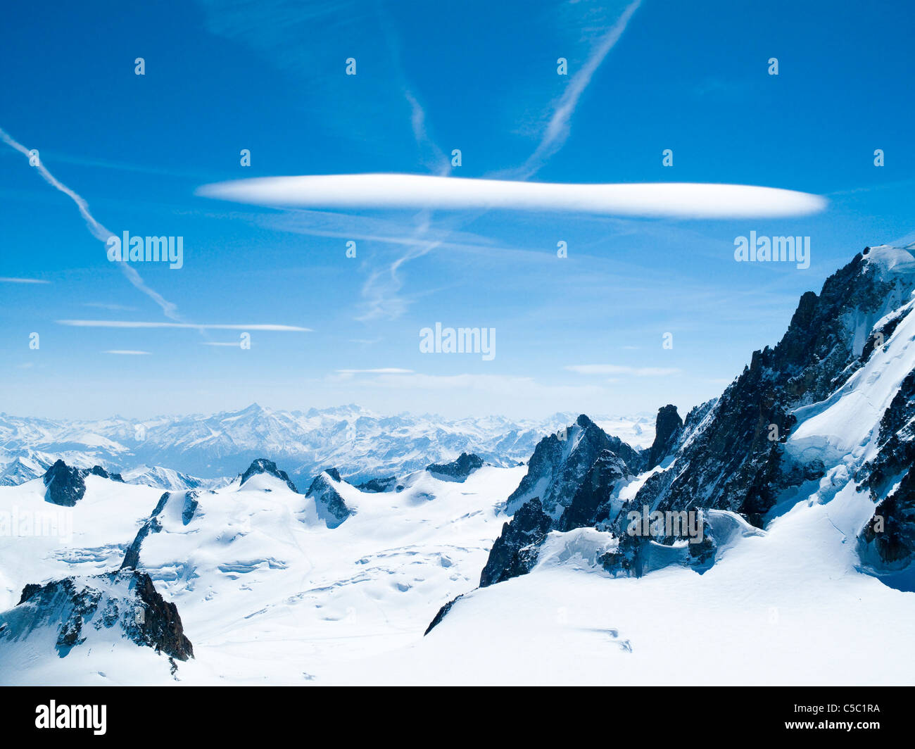 Scenic shot of lens clouds on blue sky at Chamonix Alp - Stock Image