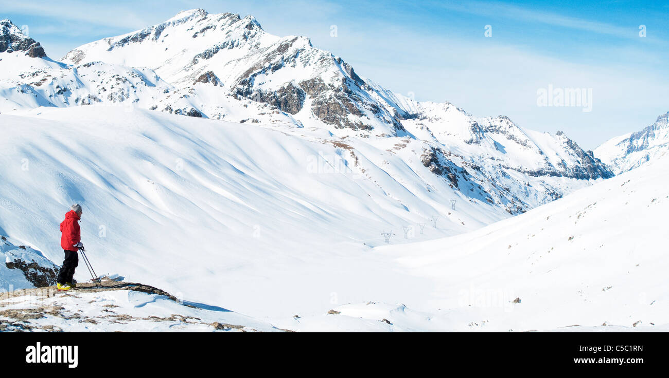 Side view of a man in a peaceful snow clad valley - Stock Image