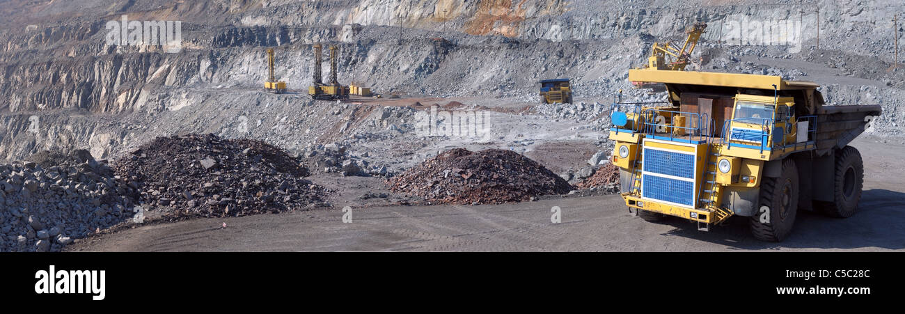 Panorama of an open-cast mine extracting iron ore - Stock Image