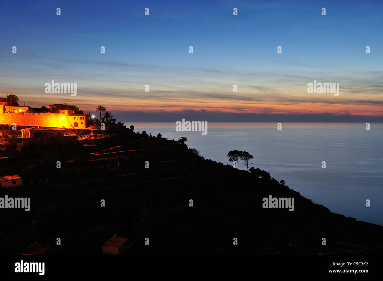 Night shot of terraced field by the Mediterranean sea - Stock Image