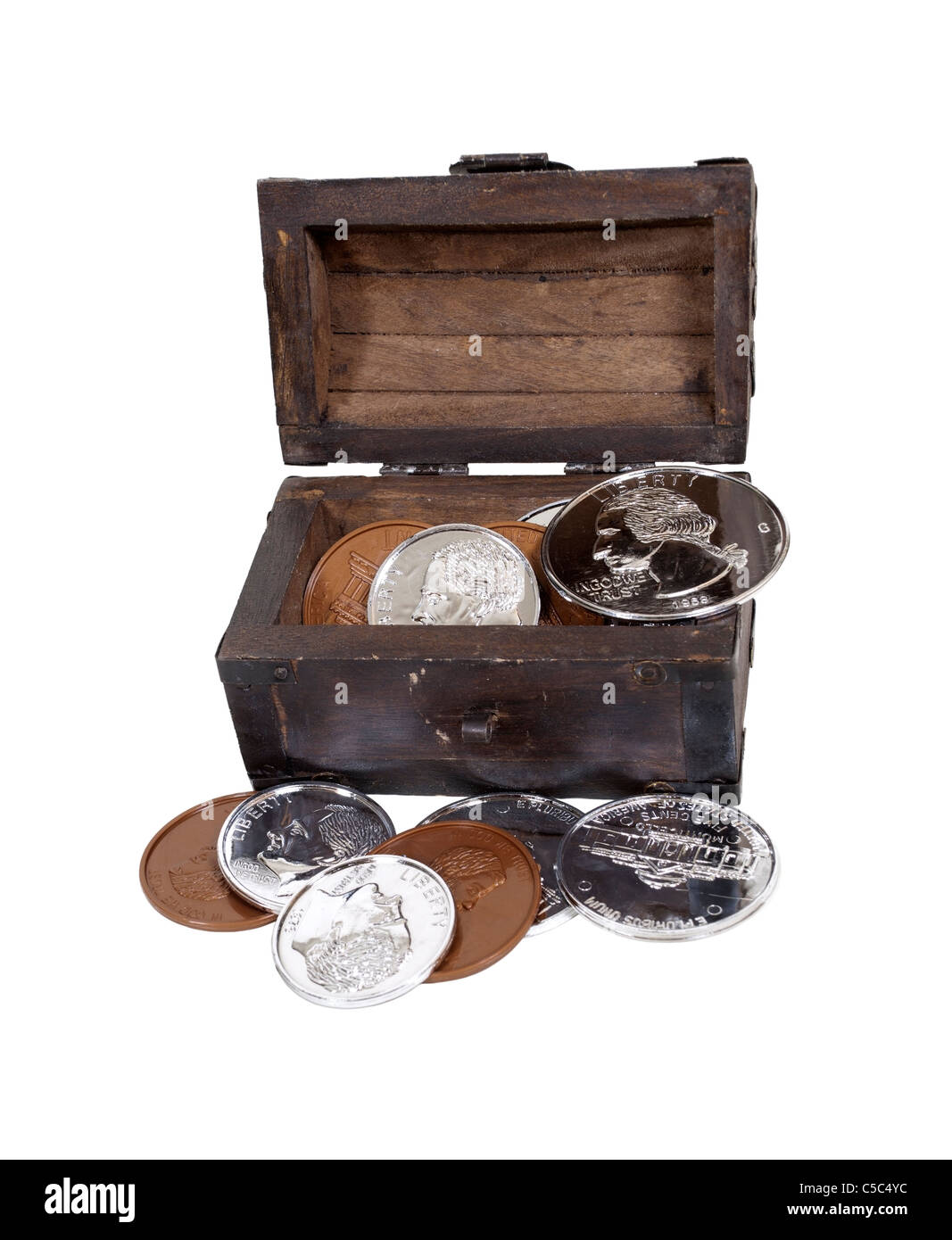 A collection of coins in a trunk representing big savings - path included - Stock Image