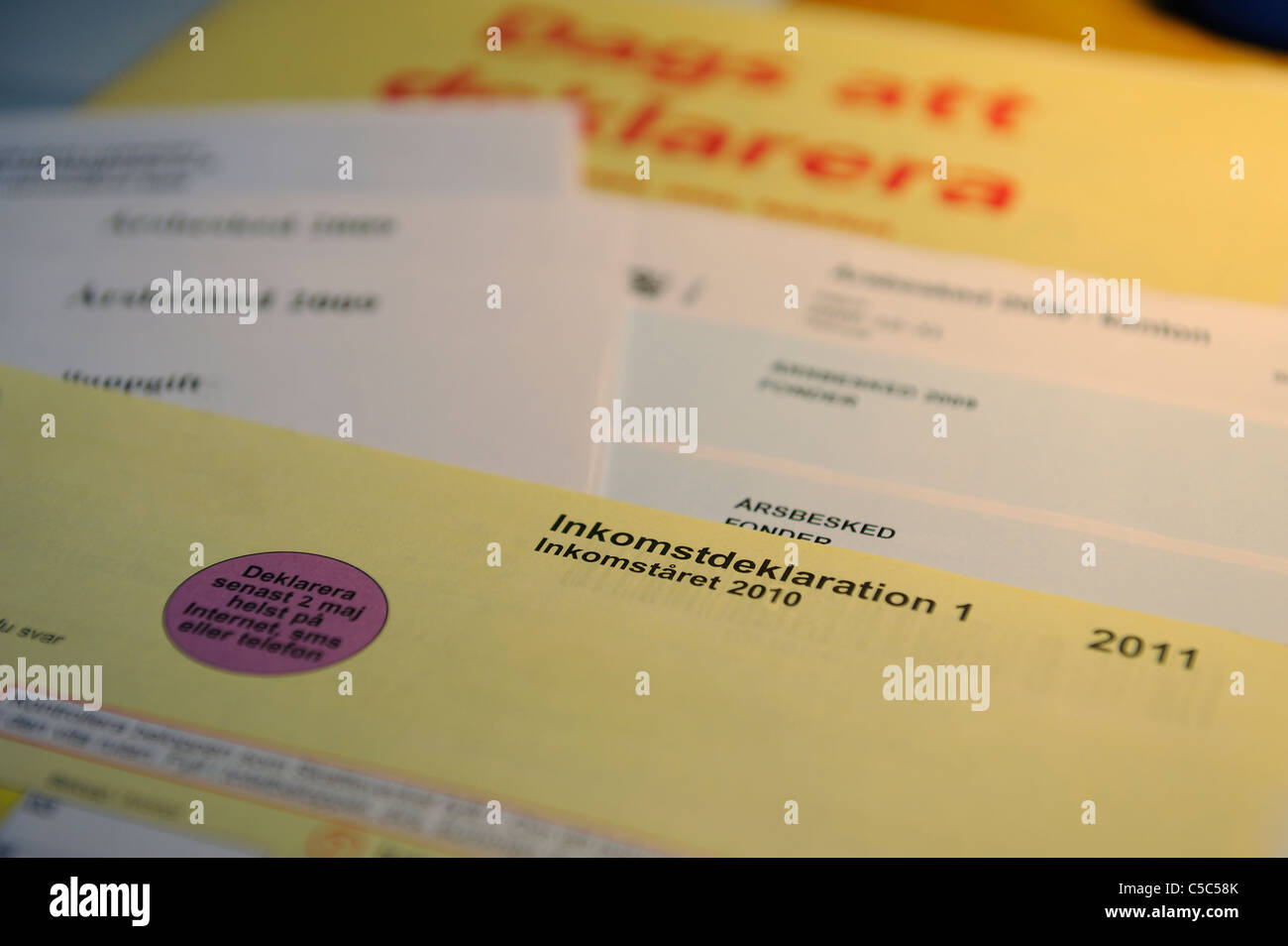 Close-up of income tax documents - Stock Image