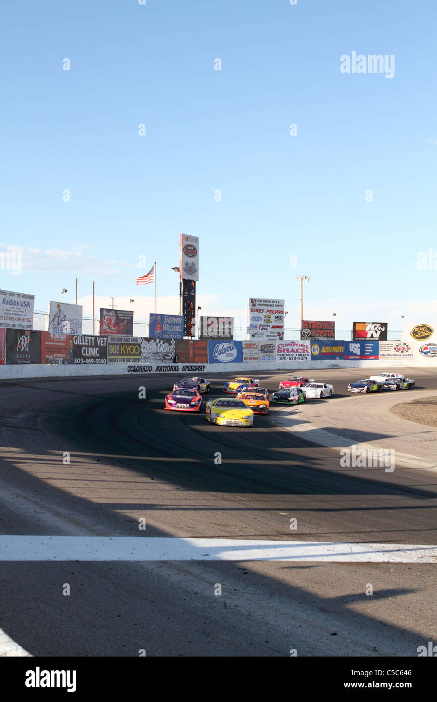 Denver, Colorado - A group of Late Model race cars round