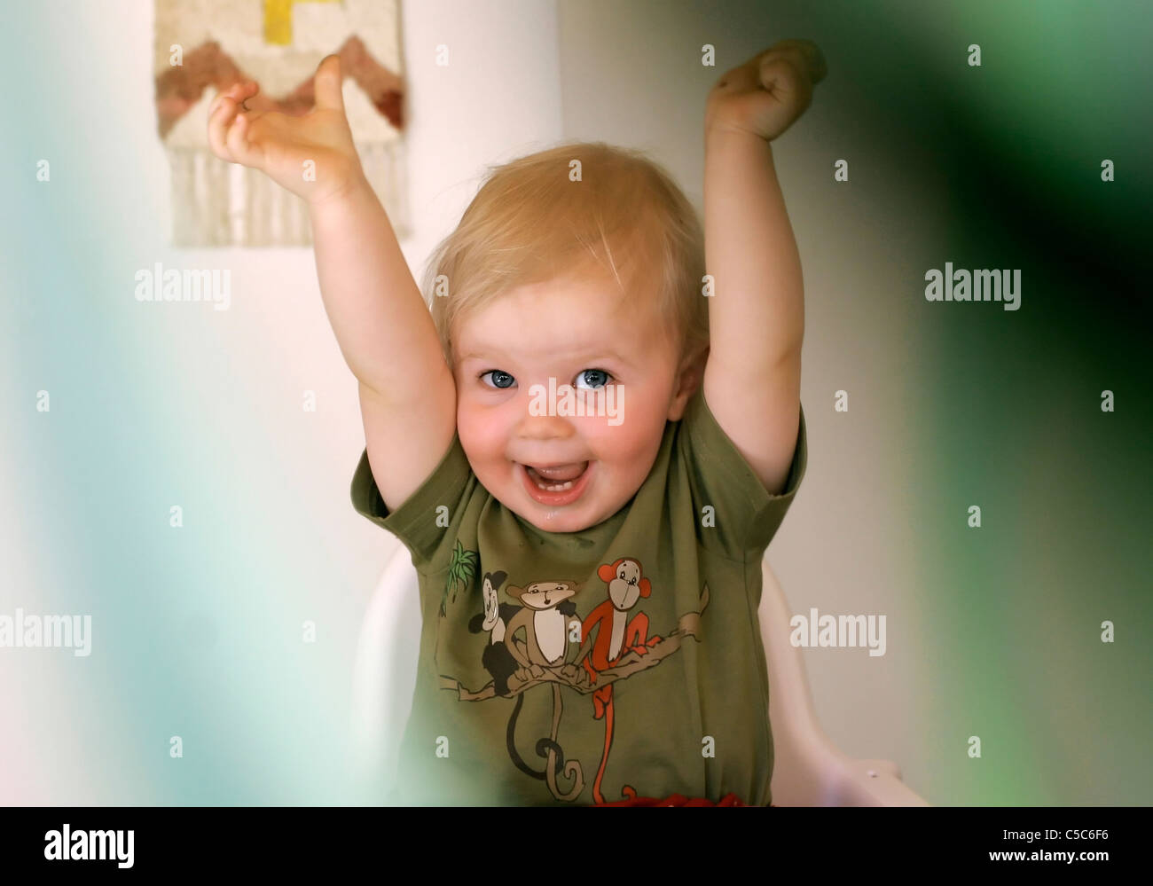 a67d55e8a59c8 Close-up portrait of a happy little girl with hands raised Stock ...
