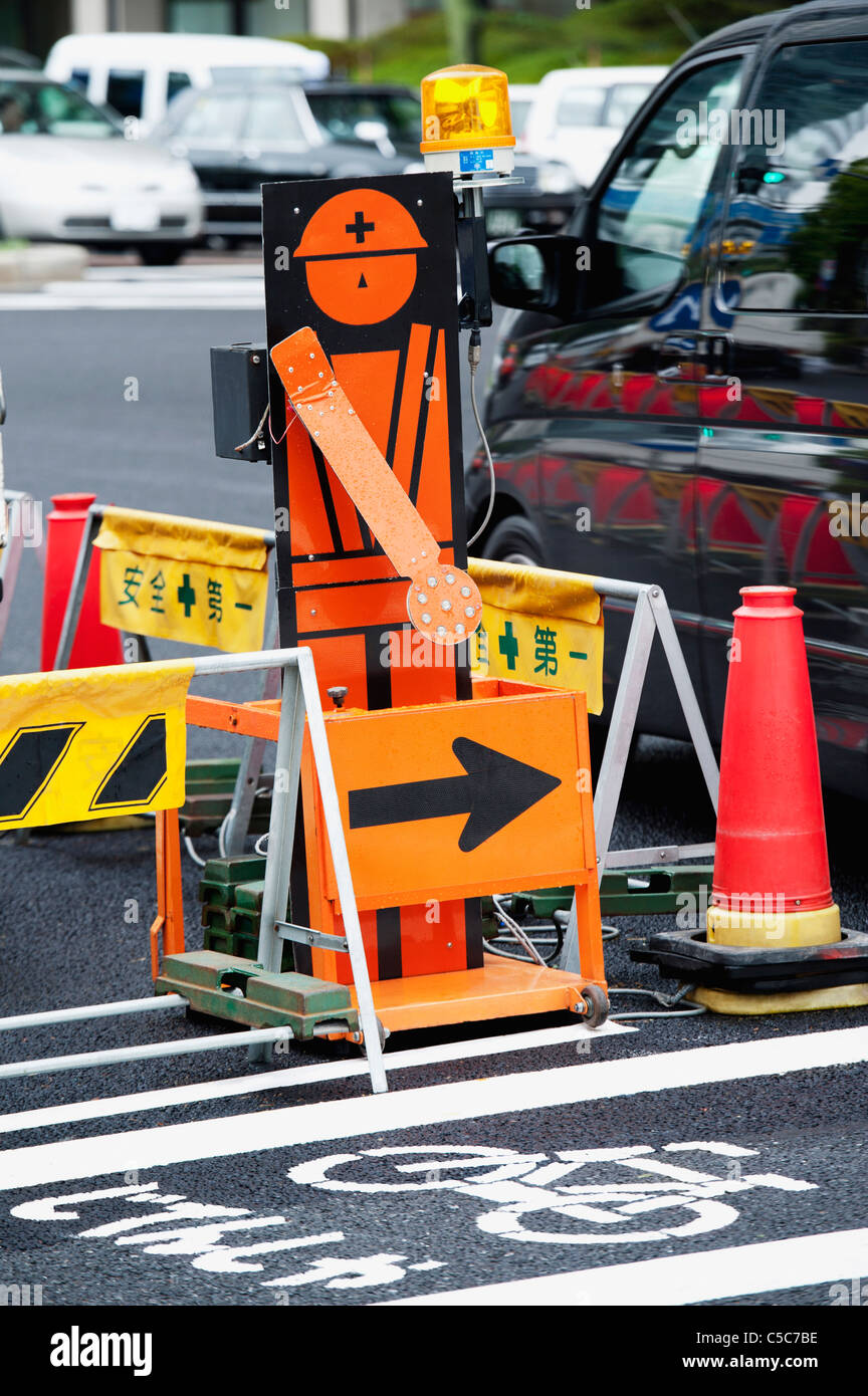 Portion Of A Street Blocked Off By Caution Markers And Pylons; Tokyo, Japan Stock Photo