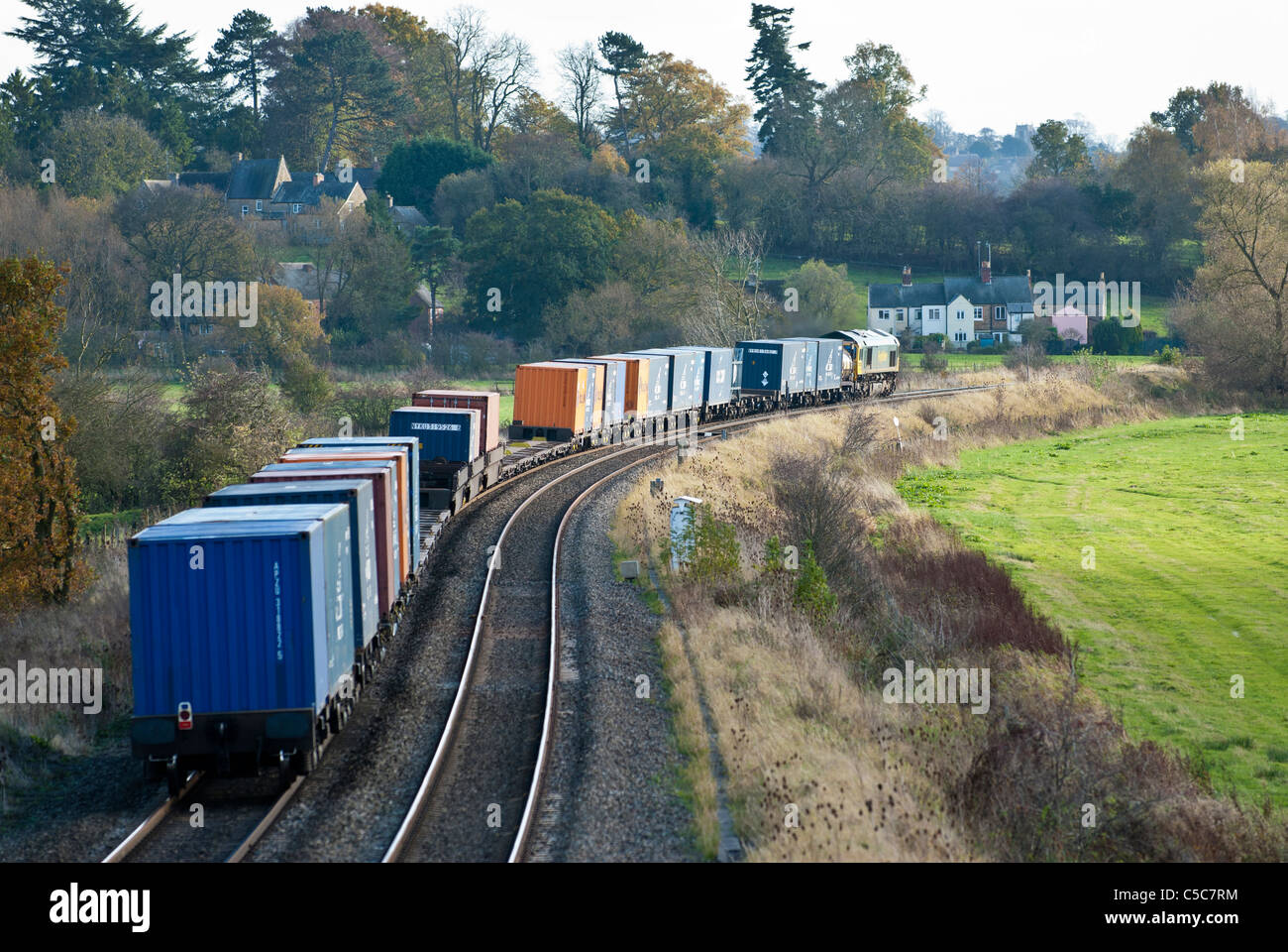 Goods train carrying freight containers - Stock Image
