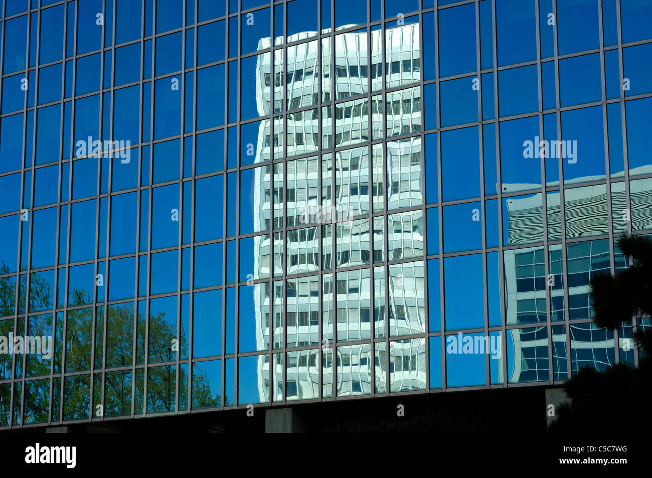 International Telecommunication Union headquarters is reflected in the glass front of an opposite building, Geneva, - Stock Image